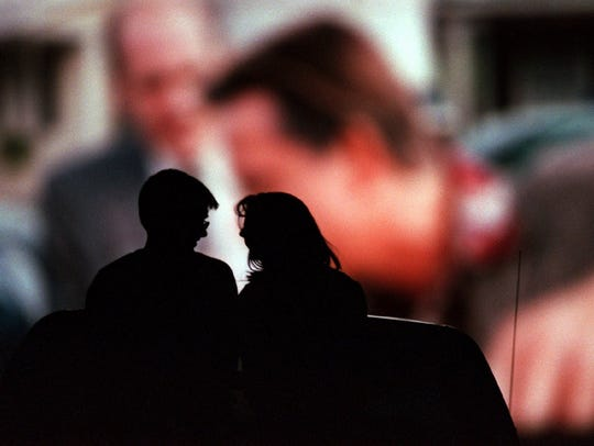 A couple enjoys a movie at the Holiday Twin Drive-In
