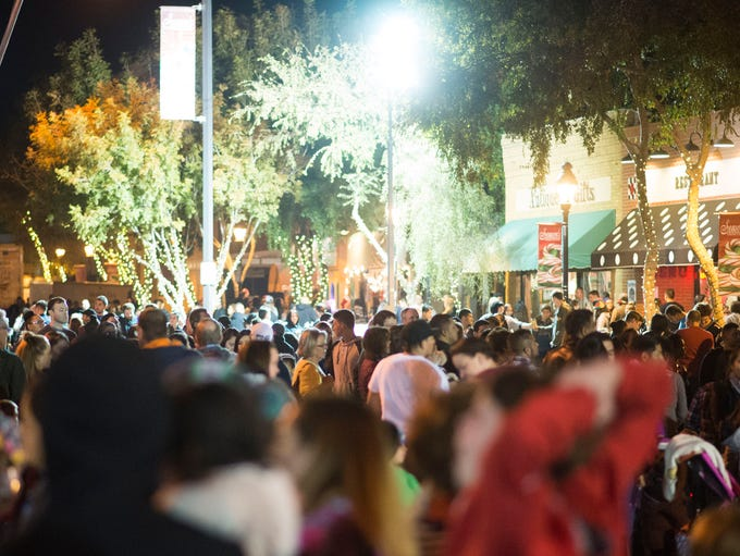 Pedestrians make their way through the annual Glendale