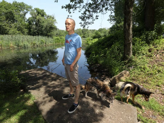 Ray LeVier stands next to the Hackensack River in the back of his home on Pineview Road in West Nyack, July 16, 2018.