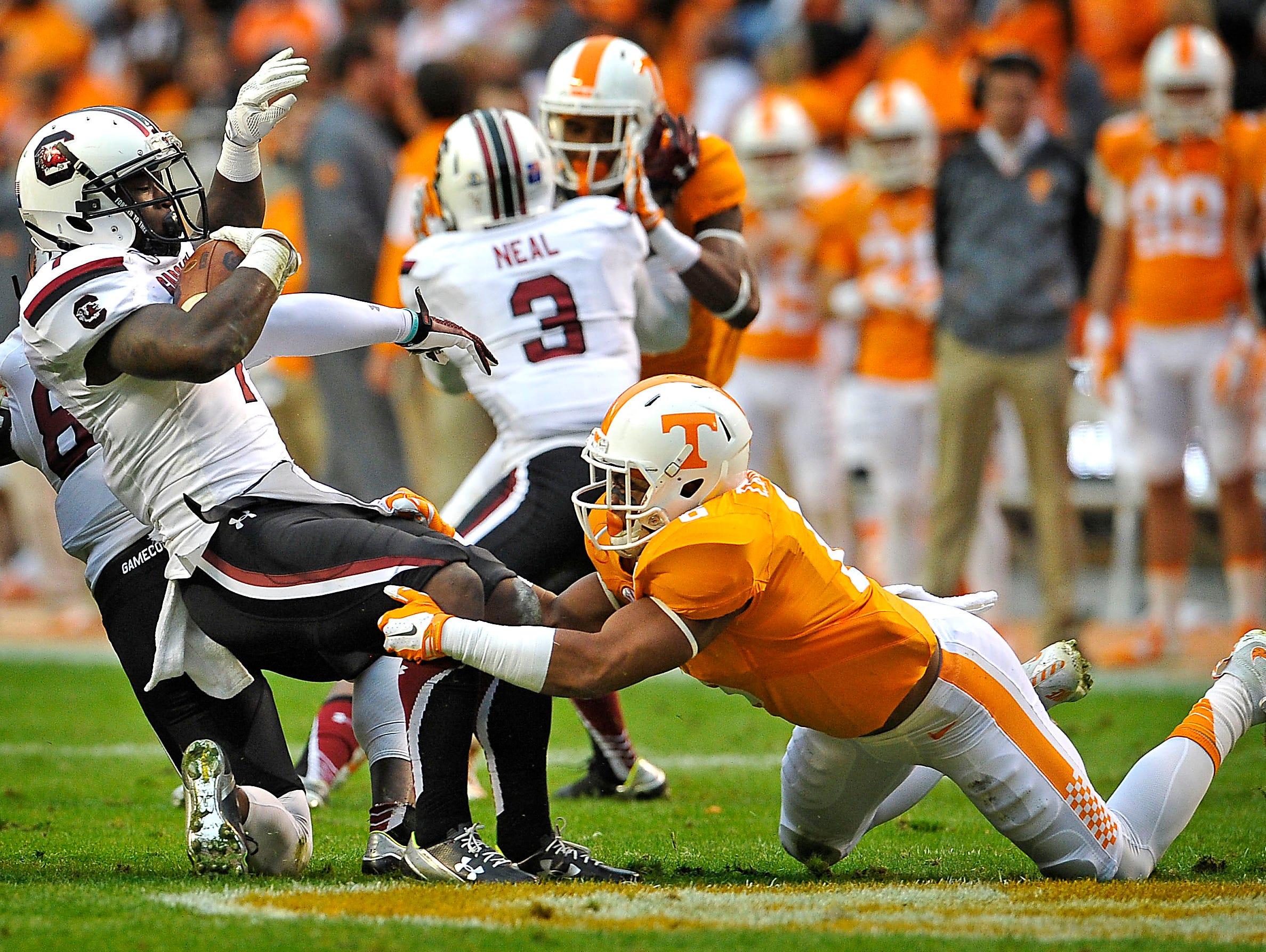 Tennessee defensive back Todd Kelly Jr. (6) tackles South Carolina running back Shon Carson (7) on Nov. 7, 2015.