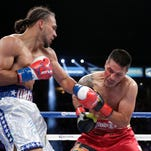 Keith Thurman, left, lands a punch to the face of Julio Diaz during the third round of a WBA interim welterweight title boxing match on Saturday.