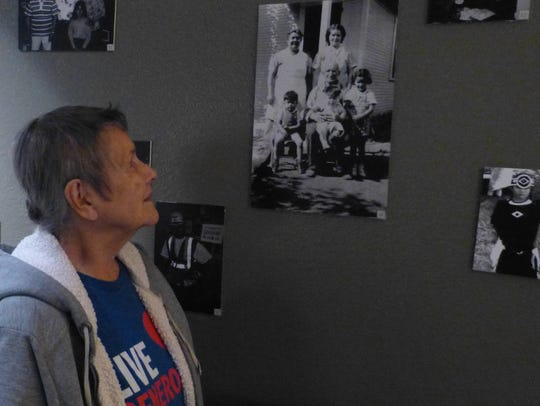 Margaret Gallego of Shasta Lake looks at a photo of