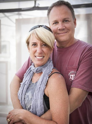 Eddie Schengber surprised Katy Farnum of Kjun Jewelry at the Midsummer Festival of Arts last year. Schengber and Farnum returned this year to mark the start of what they hope becomes a lifelong tradition.