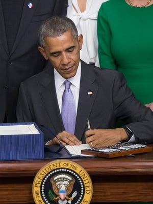 President Barack Obama signs the 21st Century Cures Act on Tuesday, Dec. 13, 2016. The 21st Century Cures Act, which was passed in Congress with overwhelming bipartisan support, provides funding for initiatives such as Vice President Joe Biden's 'Cancer Moonshot' - an effort aimed at curing cancer. The law will also provide funds for the prevention and treatment of opioid addiction and changes to the delivery of mental health services, among other provisions.
