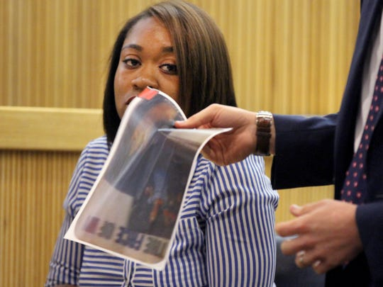 Dorothy Brown is shown behind a photo of a flier that was posted around Asbury Park.  She testified during the trial of Keith German, James Fair, and Haneef Walker at the Monmouth County Courthouse Wednesday, July 19, 2017.