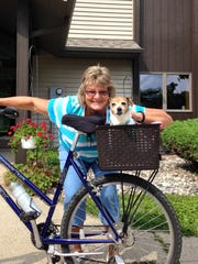 "Grand Ledge resident Cindy Larsen, with one of her dogs, started a Facebook page entitled ""Rounding Up Rodeo""  in January. Ever since, she's headed up the effort to find him."