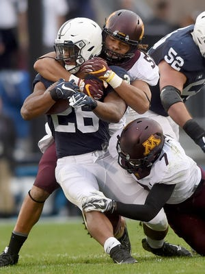 Penn State running back Saquon Barkley is taken down during the first half of Saturday's game against Minnesota at Beaver Stadium.