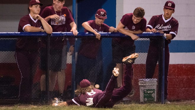 Henderson County's Maclaine Morris (8) makes a diving attempt at a foul ball during their Second Region semifinal baseball tournament game against Christian County at Christian County High School in Hopkinsville, Ky., Wednesday evening.