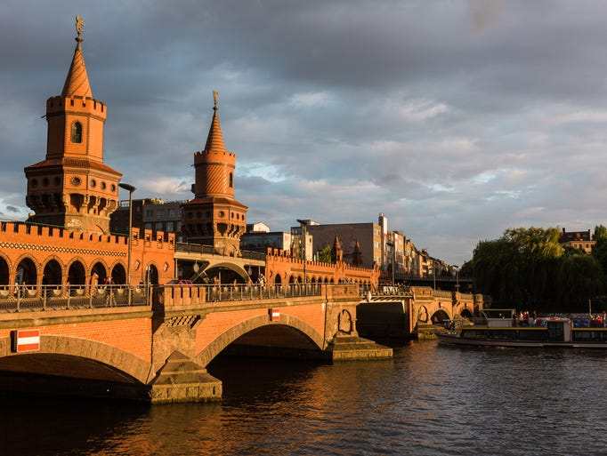 The Oberbaumbrücke spans the River Spree between Friedrichshain and Kreuzberg, districts once divided by the Berlin Wall.