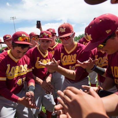 The Rocky Mountain High School baseball team celebrates