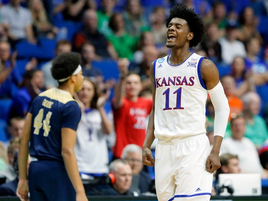 Kansas's Josh Jackson (11) celebrates a basket in front of UC Davis's Garrison Goode (44) in the first half of a first-round game in the men's NCAA college basketball tournament in Tulsa, Okla., Friday March 17, 2017. (AP Photo/Tony Gutierrez)