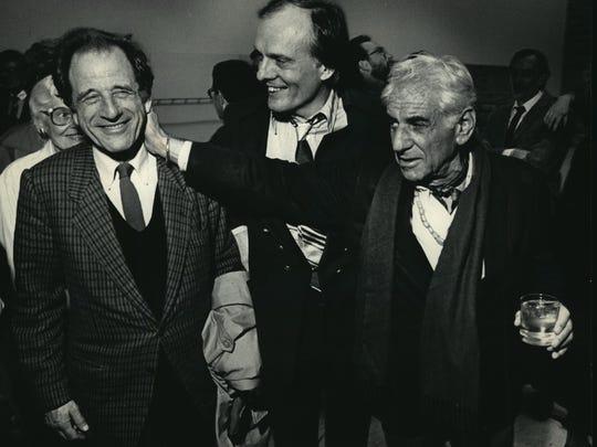 Leonard Bernstein (right) jokes with Milwaukee Symphony
