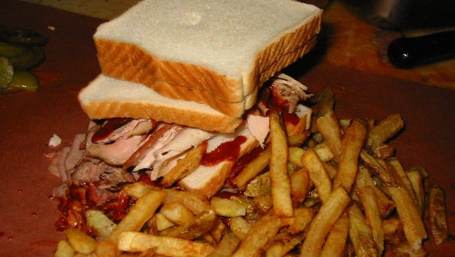 Arthur Bryant's beef and turkey combo sandwich with fries.