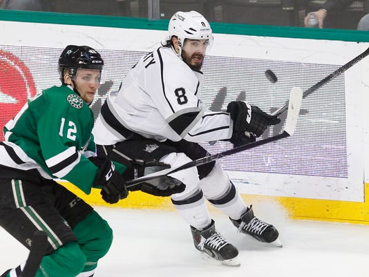 Los Angeles Kings defenseman Drew Doughty (8) and Dallas Stars center Radek Faksa (12) look for the puck during the third period of an NHL hockey game, Tuesday, March 15, 2016, in Dallas. Los Angeles won 5-2. (AP Photo/Tim Sharp)
