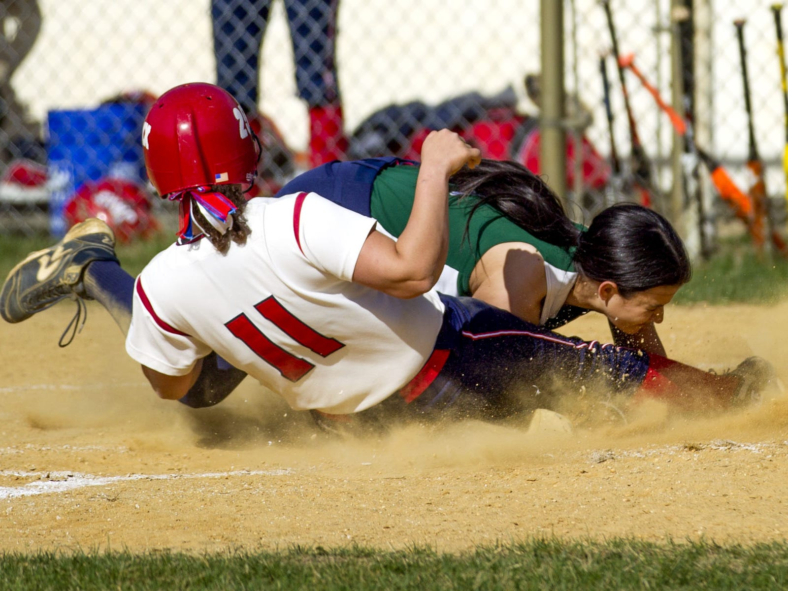 Mike McLaughlin/Correspondent Wall?s Katie Wingel slides home safely after a wild pitch by Colts Neck?s Olivia Sardoff on Thursday. Wall's Katie Wingel slides in safely at home after a wild pitch by Colts Neck's Olivia Sardoff at Colts Neck High School. Thursday, April 16, 2015, Colts Neck, NJ. Mike McLaughlin/Asbury Park Press ASB 0417 softball roundup