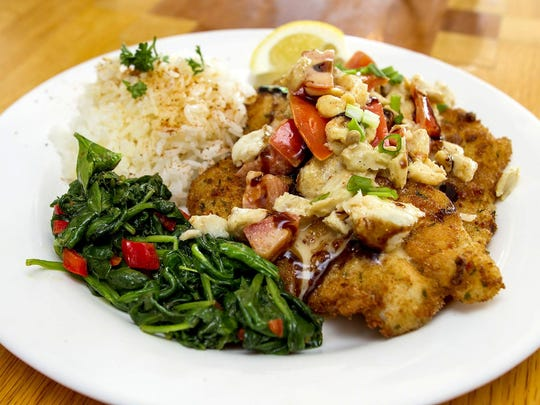 Parmesan encrusted Flounder with lump crab, fresh tomatoes and balsamic green onions with white rice and saut?ed spinach at the F-Cove Restaurant, specializing in Cajun and Creole inspired dishes, in Brick. Friday, May 29, 2015. Brick, NJ. Mike McLaughlin/Asbury Park PressASB 0529 F COVE