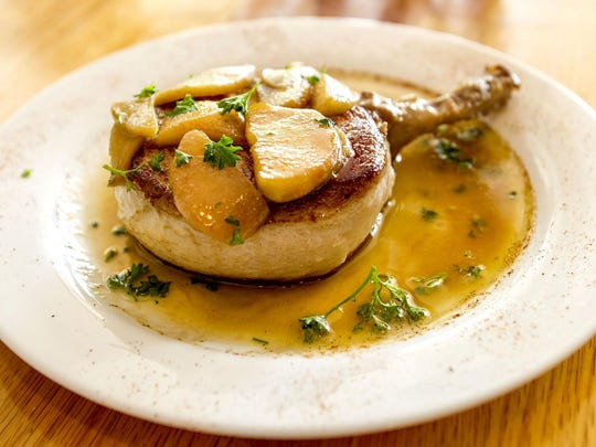 Prime Bone and Pork Chop topped with bourbon glazed apples at the F-Cove Restaurant, specializing in Cajun and Creole inspired dishes, Brick. Friday, May 29, 2015. Brick, NJ. Mike McLaughlin/Asbury Park PressASB 0529 F COVE