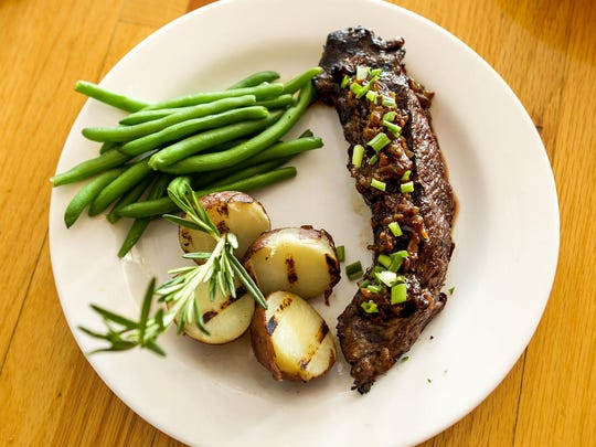 Hanger Steak with bourbon bacon jam, red potatoes and green beans at the F-Cove Restaurant, specializing in Cajun and Creole inspired dishes, in Brick. Friday, May 29, 2015. Brick, NJ. Mike McLaughlin/Asbury Park PressASB 0529 F COVE