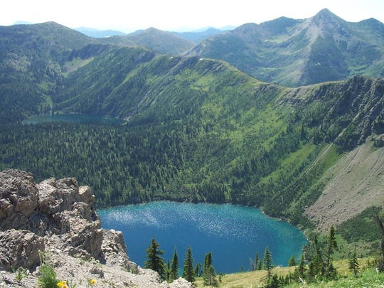 Tranquil Basin is one of many hikes accessible from U.S. Highway 2. The trail passes above a beautiful basin of alpine lakes.