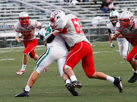 St. Joseph Central Catholic's Ben Wonderly brings down an Ottawa Hills runner in a game last season.