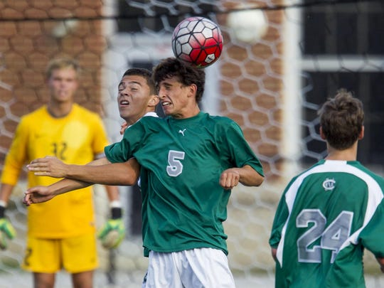 Colts Neck's Dean Raynor and Long Branch's Venancio Mendes Fernandes go up for a header during the game at Long Branch High School. Friday, October 9, 2015, Long Branch, NJ. Mike McLaughlin/Asbury Park Press ASB 1010 combo roundup