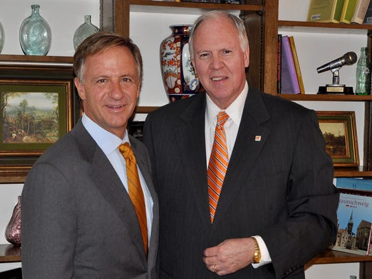 UTM Chancellor Tom Rakes, right, shown here with Gov. Bill Haslam, stepped down on May 31, 2015, to take a teaching position at UTM.