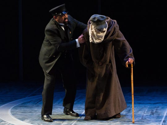"""Hassan El Amin, who plays multiple roles, and Michael Gotch as John Merrick in the REP production of """"The Elephant Man."""""""
