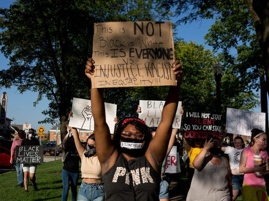 Protesters hold up signs at a peaceful Black Lives Matters rally on June 2, 2020, in downtown Newark.
