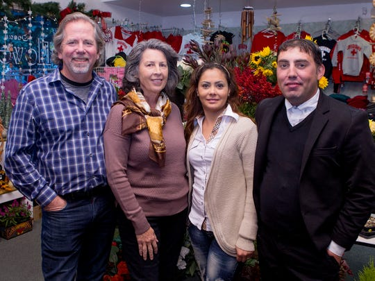 Jay and Cathy Sullivan (left), of Red Bank, and Ilinca and Marius Dumitriade at the Ocean Grove Flower & Gift Shop.