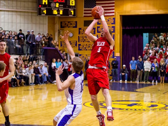 Point Beach's Michael Frauenheim shoots for three against St. Rose at St. Rose High School. Tuesday, December 23, 2014, Belmar, NJ. Mike McLaughlin/Asbury Park Press ASB 1224 PBeach at SRose BBall gamer