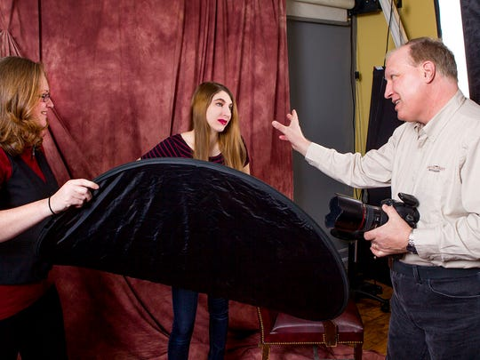 John Pacetti, owner of South Street Photography, and his associate Lauren Kuhn, left, work with John's daughter, Diana, for a quick portrait session at the studio in Freehold Township.