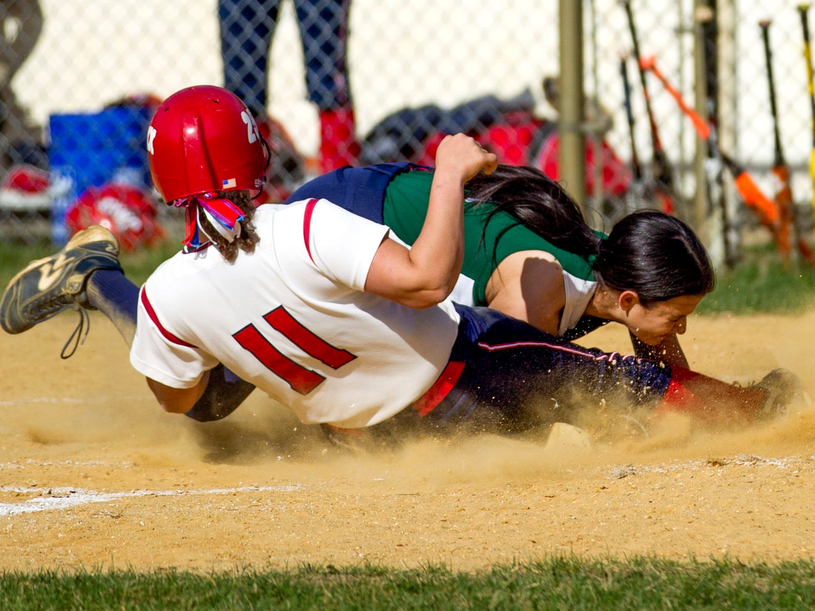 Wall's Katie Wingel slides in safely at home after a wild pitch by Colts Neck's Olivia Sardoff at Colts Neck High School. Thursday, April 16, 2015, Colts Neck, NJ. Mike McLaughlin/Asbury Park Press ASB 0417 softball roundup