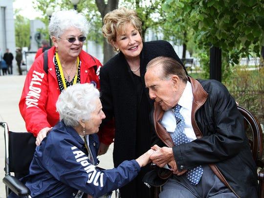 Marian Cyberski speaks with Senator Bob Dole and his wife, Elizabeth, in Washington, D.C., Saturday morning.