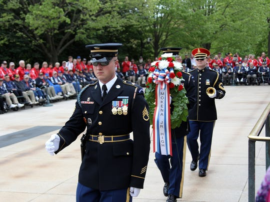 World War II veterans watch the changing of the guards at Arlington National Cemetery Saturday afternoon.
