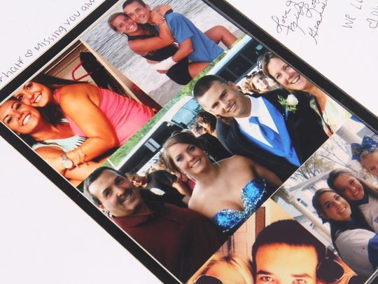 """Photographs of Nicole Surace are displayed at the """"Only the Good Fly Young"""" remembrance walk to benefit a scholarship fund in her name this year at Monmouth University's Kessler Field in West Long Branch. Surace and her boyfriend, Jeffrey Szatkowski Jr., were killed in a Thanksgiving weekend car accident in 2013."""