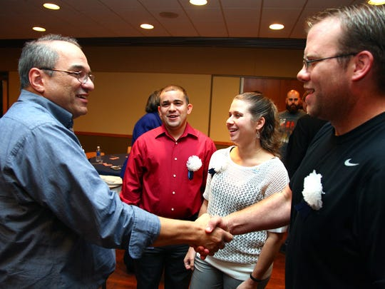 The Middlesex County College community had the opportunity to get to know its military veterans at a meet and greet event in November. From left: Navy veteran and MCC Natural Sciences professor James Martiney; Paul Lazaro, assistant in the Center for Veterans Services and an Army veteran; Kayleigh Maklary '10, assistant in the MCC Foundation and an Army veteran; and Navy veteran Christopher Pellegrino, MCC student and the president of the College's Veterans and Servicemembers Association.