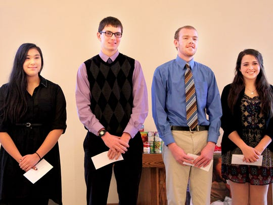 The Chemung Chapter of the Daughters of the American Revolution recently honored top local students with DAR Good Citizen awards. Pictured, from left, are: Genevieve Hartman of Elmira Christian Academy, Jacob Malloy of Horseheads High School, Joshua Wilson of Elmira High School and Mary Catherine Landy of Notre Dame High School.