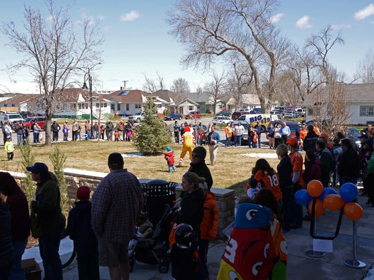 Several hundred Bronco fans line the sidewalk at the Windsor Town Hall on Monday to get autographs of current and former players and cheerleaders. Some of the Denver Broncos along with cheerleaders and Miles, the mascot, visited Windsor as part of the Broncos' Mile High Salute to Fans Tour.