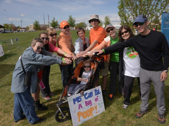 A group of participants pause for a photo just before the beginning of the Walks MS Northern Colorado event held Saturday at Boardwalk Park in Windsor. The event raised $180,000 for Multiple Sclerosis, and the event included 10 corporate sponsors and 70 volunteers.