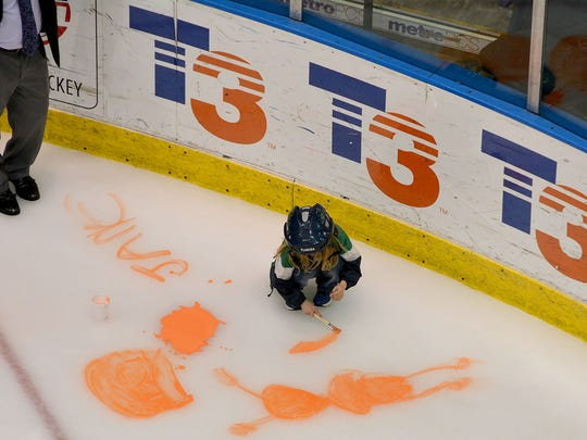 A young Florida Everblades fan leaves her mark during the team's Paint The Ice night on Friday at Germain Arena.