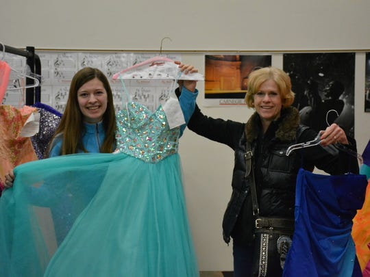 Lydia Olejniczak, a sophomore from Algoma, and her mother, Sara, shop for dresses at the 4-H Teen Association Prom Dress Sale.
