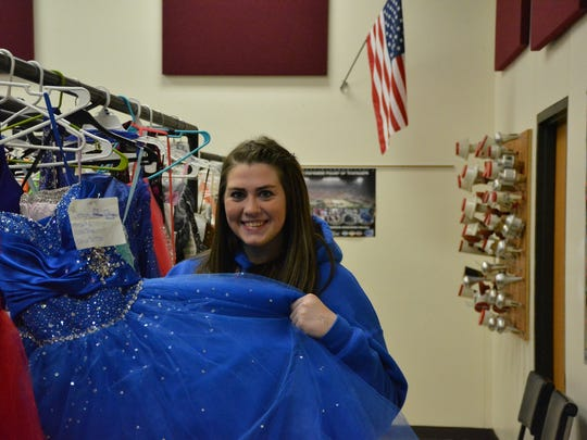 Torie Benzshawel, a senior at Luxemburg-Casco High School, looks through prom dresses at the 4-H Teen Association Prom Dress Sale.