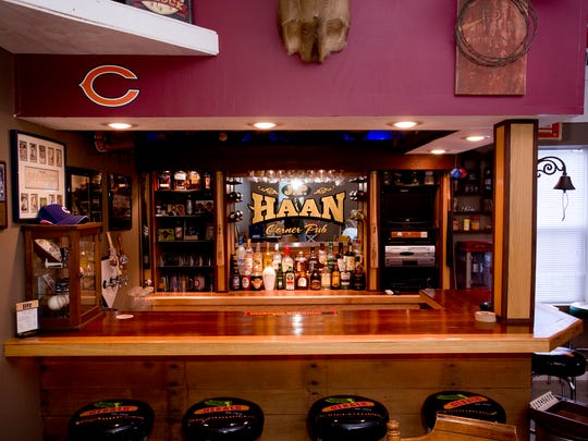 The walnut bar in Pat Haan's man cave is equipped for draft beer.