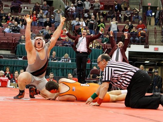 Genoa's Jay Nino celebrates after his pin for a state championship last season.