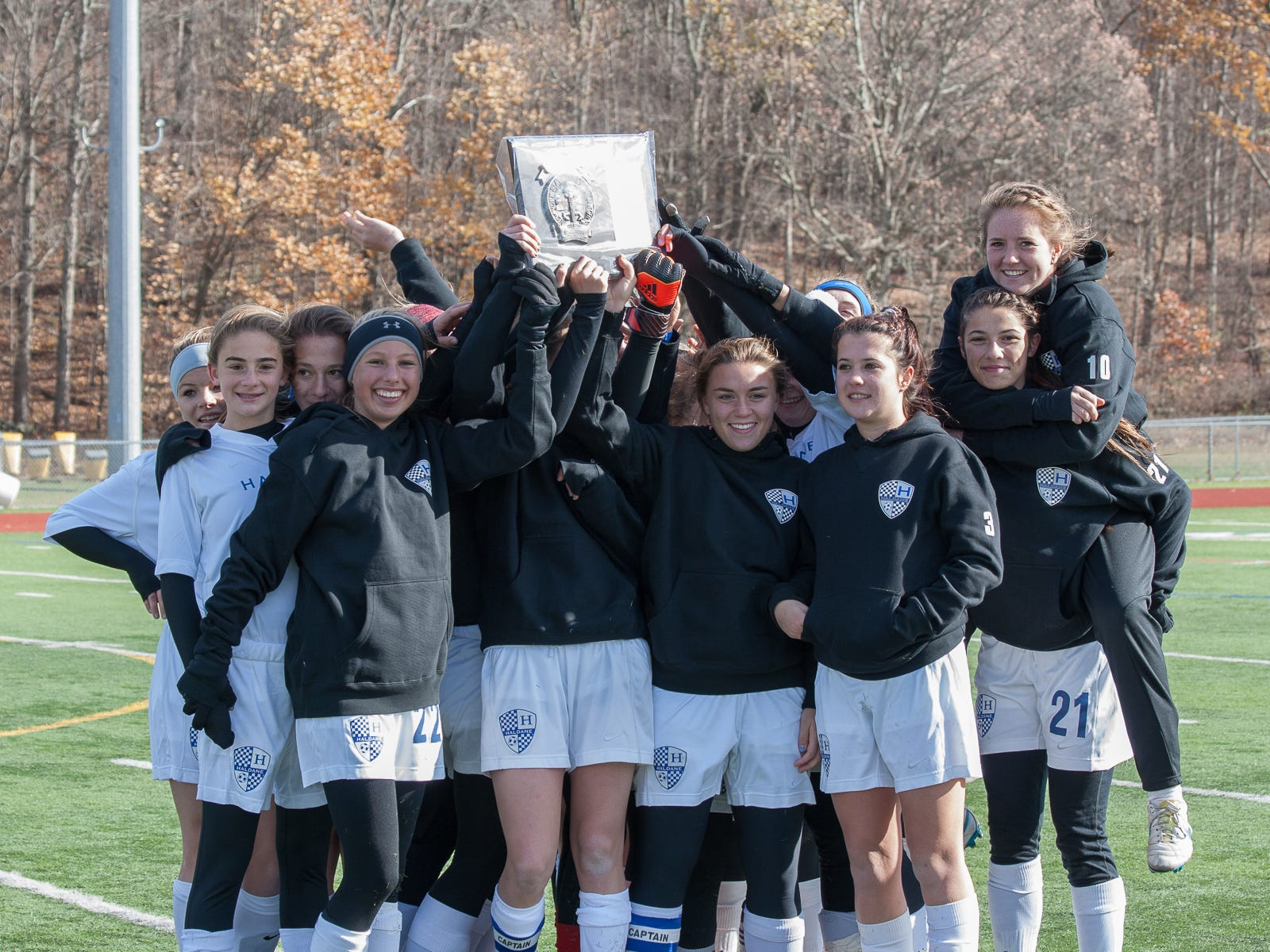 The Haldane High School girls soccer team celebrates its Section 1 Class C title at Arlington High School in Freedom Plains.