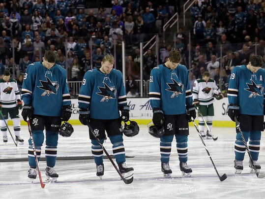 San Jose Sharks' Tomas Hertl, from the Czech Republic; Mikkel Boedker, from Denmark; Justin Braun; and Logan Couture, from left, observe a moment of silence with Minnesota Wild players, rear, for the victims of a bus crash involving a youth hockey team in Canada, before an NHL hockey game in San Jose, Calif., Saturday, April 7, 2018. (AP Photo/Jeff Chiu)