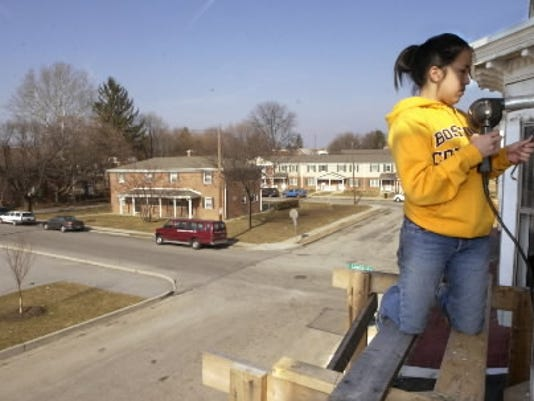 In this file photo from 2004, Liz Byron, then a sophomore at Boston College volunteered with York Habitat for Humanity during her spring break.