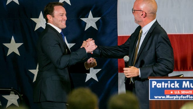 Democratic U.S. Rep. Patrick Murphy (left) celebrates with U.S. Rep. Ted Deutch at the Doubletree Hotel on Aug. 30 in Palm Beach Gardens after Murpehy defeated U.S. Rep. Alan Grayson in the state's Senate primary election.