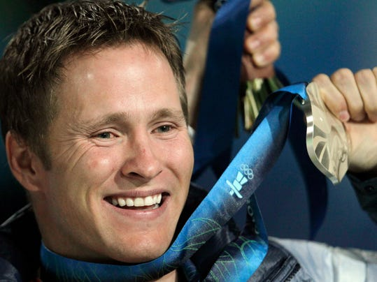 """FILE - In this file photo taken Feb. 26, 2010, Jeret speedy Peterson, of the Boise, Idaho, as he holds his silver medal during the medals ceremony for the men's freestyle skiing aerials at the Vancouver 2010 Olympics in Vancouver, British Columbia. American freestyle skier Mac Bohonnon will pay tribute to one of his sport's most fascinating and beloved characters if the conditions are right. And if that goes well he might find himself with an Olympic medal hanging around his neck, too. Bohonnon has been working on the """"Hurricane,"""" the same trick the late Jeret Speedy Peterson landed eight years ago to win his silver medal in aerials. (AP Photo/Gerry Broome, File)"""