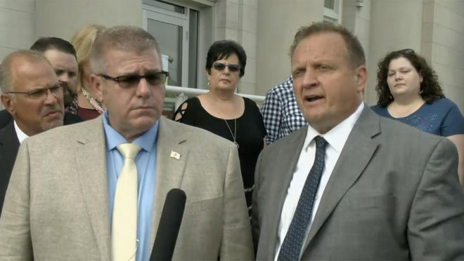 Illinois Rep. Darren Bailey, left, R-Xenia, and his attorney, Thomas DeVore, speak to reporters Thursday outside the Clay County Courthouse in Louisville after a judge there ruled that all of Gov. JB Pritzker's executive orders since April 8 pertaining to the novel coronavirus pandemic are void because he exceeded his authority when he used his emergency powers for more than 30 days.
